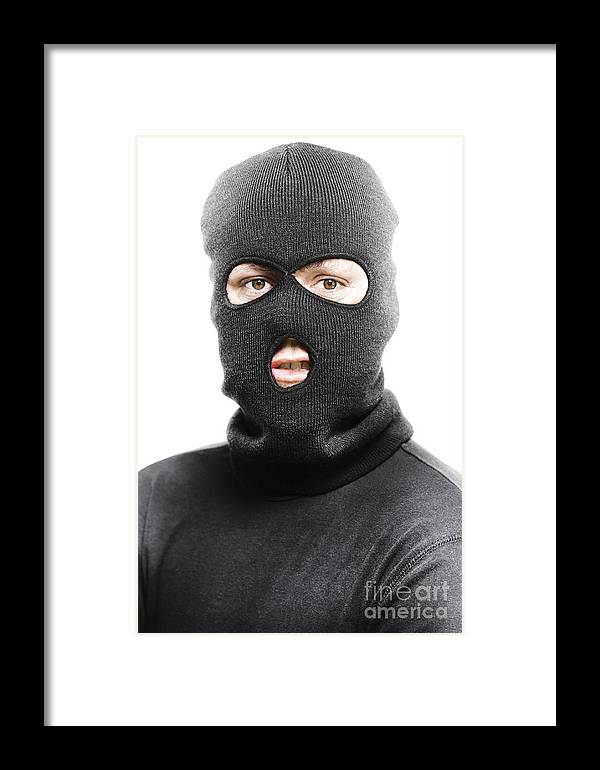 Background Framed Print featuring the photograph Face Of A Burglar Wearing A  Ski Mask Or Balaclava 07d924fcb27f
