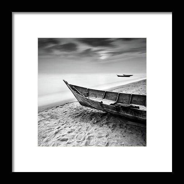 Tranquility Framed Print featuring the photograph Fisherman Boat At Beach In Black And by Photography By Azrudin