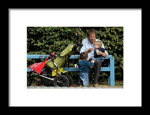 Working Framed Print featuring the photograph Germany Debates Expanding Parental Leave by Sean Gallup