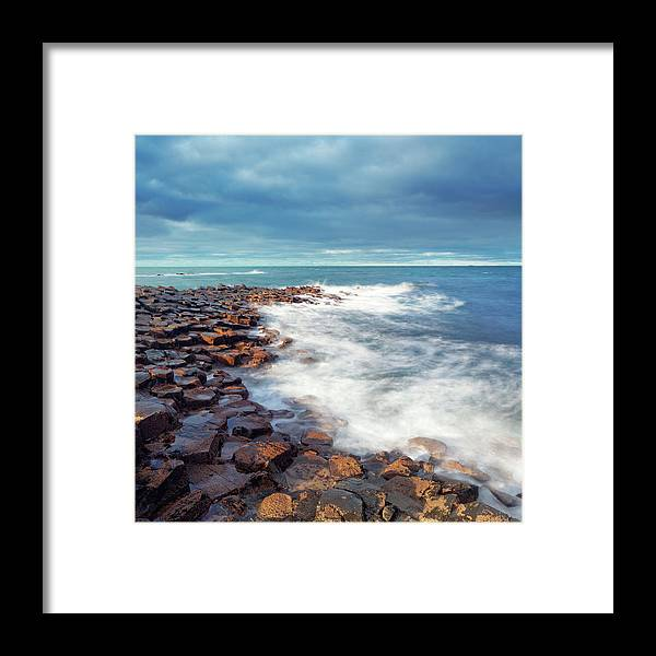 Water's Edge Framed Print featuring the photograph Giants Causeway On A Cloudy Day by Mammuth