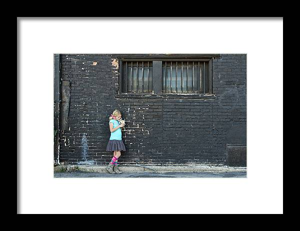 Adolescence Framed Print featuring the photograph Girl Standing Next To Brick Wall by Jennifer Huls