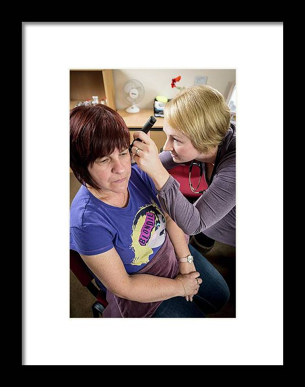 Human Framed Print featuring the photograph Gp Examining Patient by Jim Varney