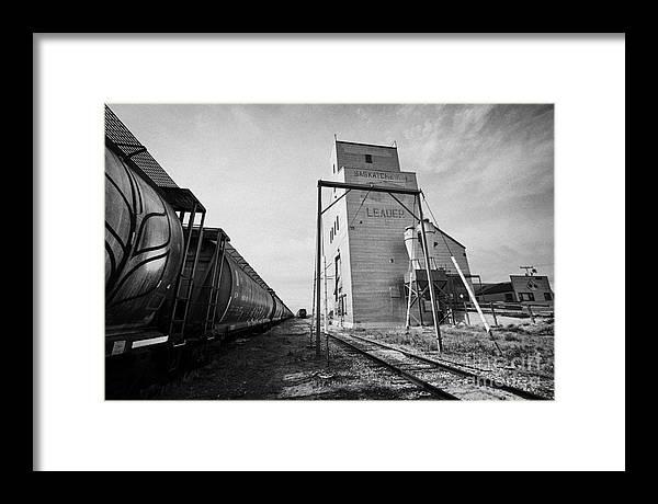 Grain Framed Print featuring the photograph grain elevator and old train track with grain railcars leader Saskatchewan Canada by Joe Fox