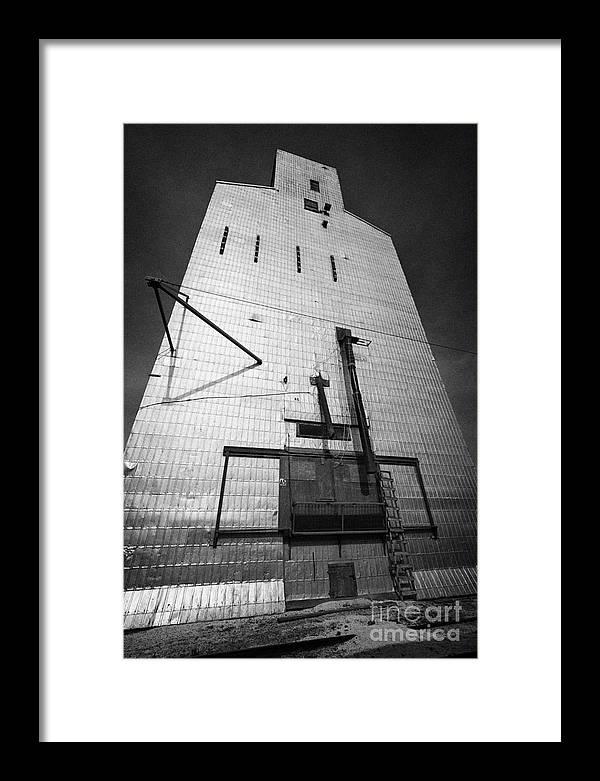 Grain Framed Print featuring the photograph grain elevator doors and filling pipe leader Saskatchewan Canada by Joe Fox