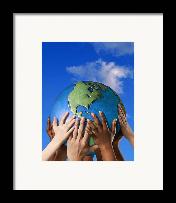 Adult Framed Print featuring the photograph Hands On A Globe by Don Hammond