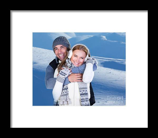Adult Framed Print featuring the photograph Happy Couple Playing Outdoor At Winter Mountains by Anna Om
