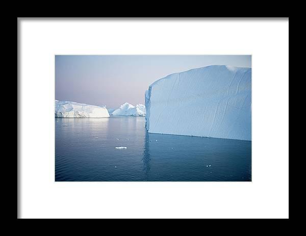 Melting Framed Print featuring the photograph Icebergs Of Ilulissat Kangerlua by Holger Leue