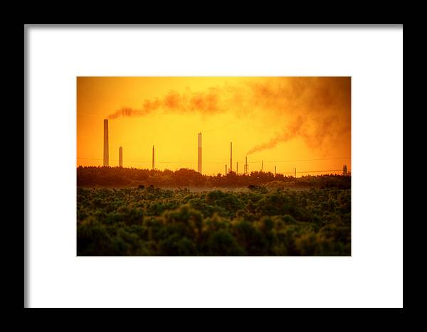 Landscape Framed Print featuring the photograph Industrial Chimney Stacks In Natural Landscape Polluting The Air by Matthew Gibson