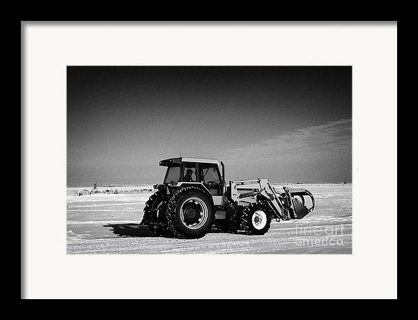 International Framed Print featuring the photograph international 5140 tractor with front end loader on frozen field Forget Saskatchewan Canada by Joe Fox