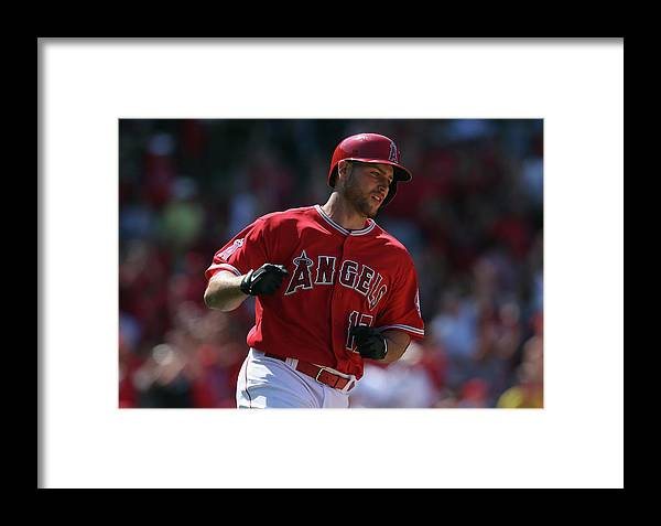 Fist Framed Print featuring the photograph Kansas City Royals V Los Angeles Angels 1 by Jeff Gross