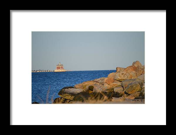 Ledge Light On The Rocks Framed Print featuring the photograph Ledge Light by Jessica Cruz