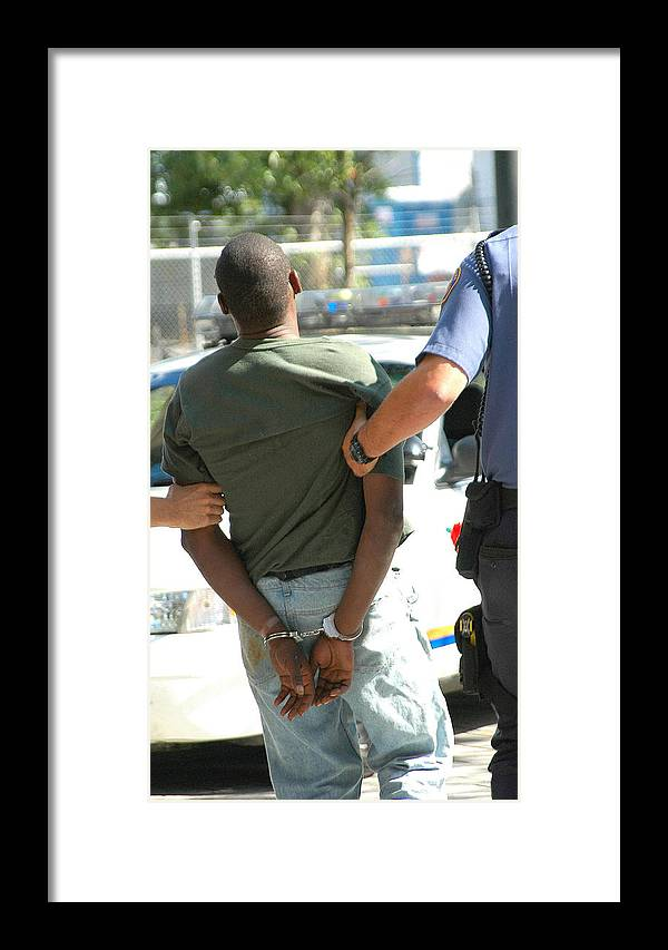 African American Framed Print featuring the photograph Man Arrested. by Oscar Williams