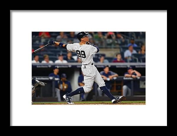 People Framed Print featuring the photograph Milwaukee Brewers v New York Yankees by Mike Stobe