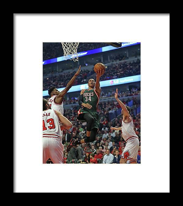 Playoffs Framed Print featuring the photograph Milwaukee Bucks V Chicago Bulls - Game by Jonathan Daniel