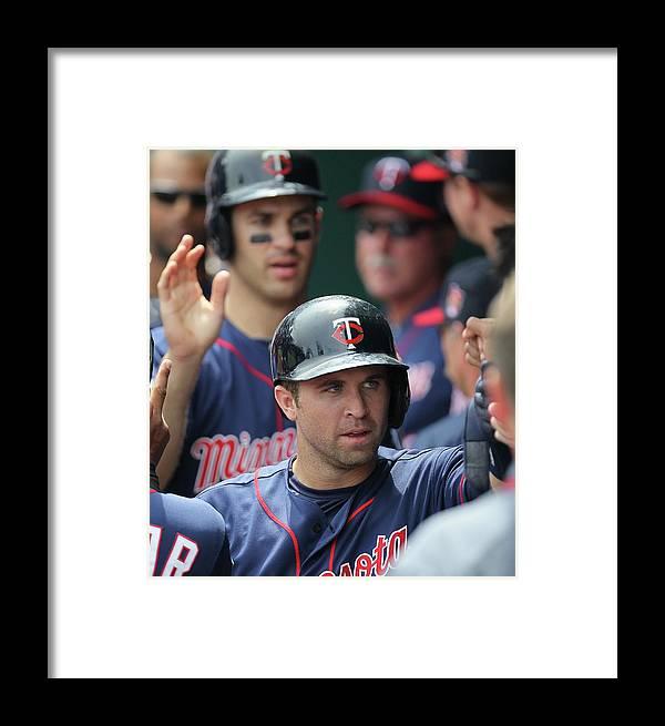 Joe Mauer Framed Print featuring the photograph Minnesota Twins V Kasnas City Royals 1 by Ed Zurga