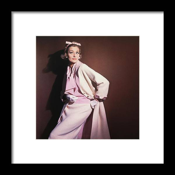 Studio Shot Framed Print featuring the photograph Model Wearing White Coat Over Pink Blouse by Horst P. Horst