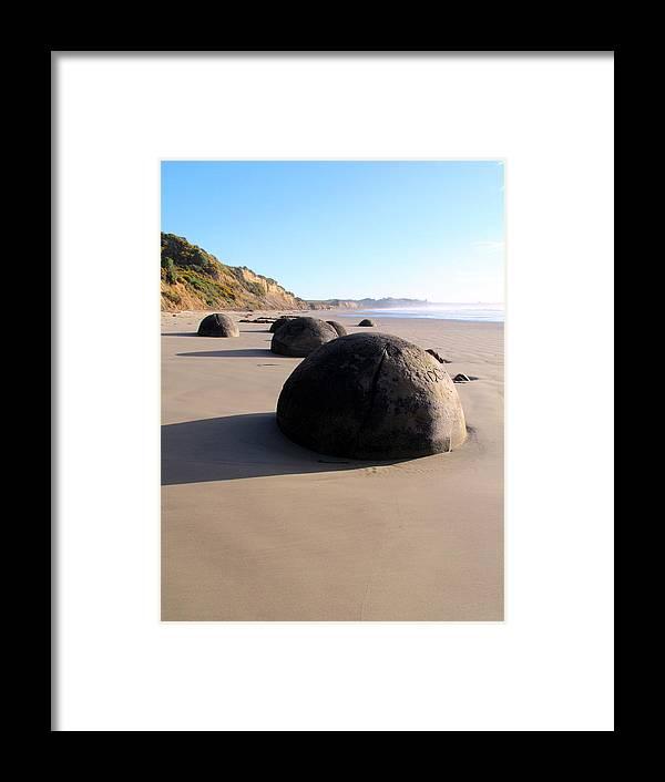 Boulders Framed Print featuring the photograph Moeraki Boulders by Joyce Woodhouse