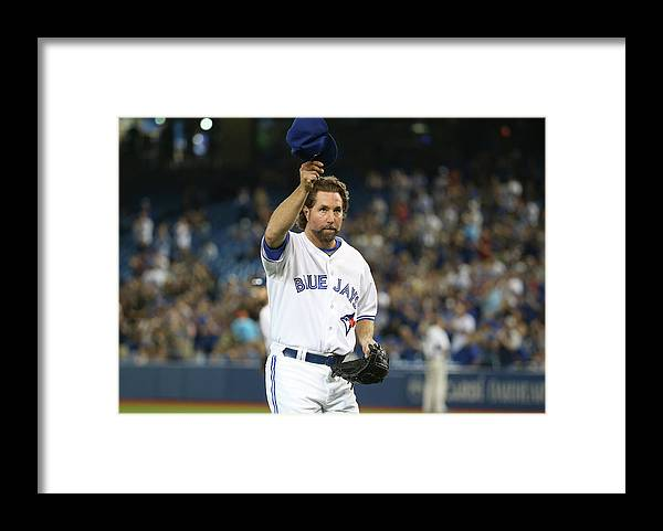 People Framed Print featuring the photograph New York Mets V Toronto Blue Jays by Tom Szczerbowski