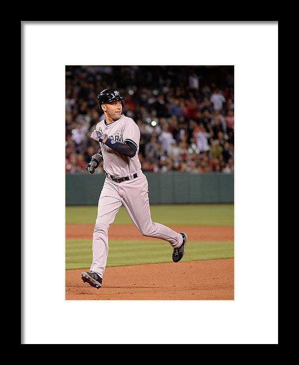 People Framed Print featuring the photograph New York Yankees V Los Angeles Angels 1 by Harry How