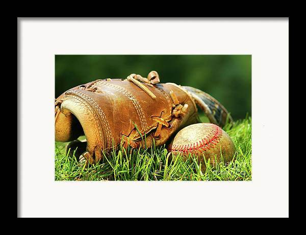 Ball Framed Print featuring the photograph Old Glove And Baseball by Sandra Cunningham