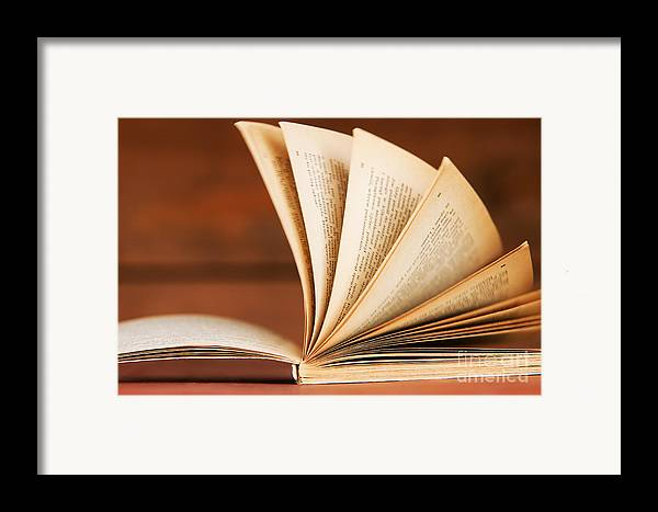Article Framed Print featuring the photograph Open Book In Retro Style by Michal Bednarek