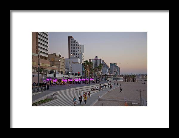 People Framed Print featuring the photograph Seaside Promenade Of Tel Aviv At Dusk by Barry Winiker