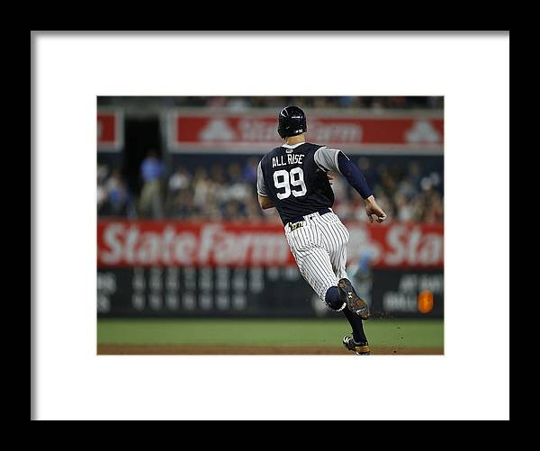 People Framed Print featuring the photograph Seattle Mariners v New York Yankees by Rich Schultz