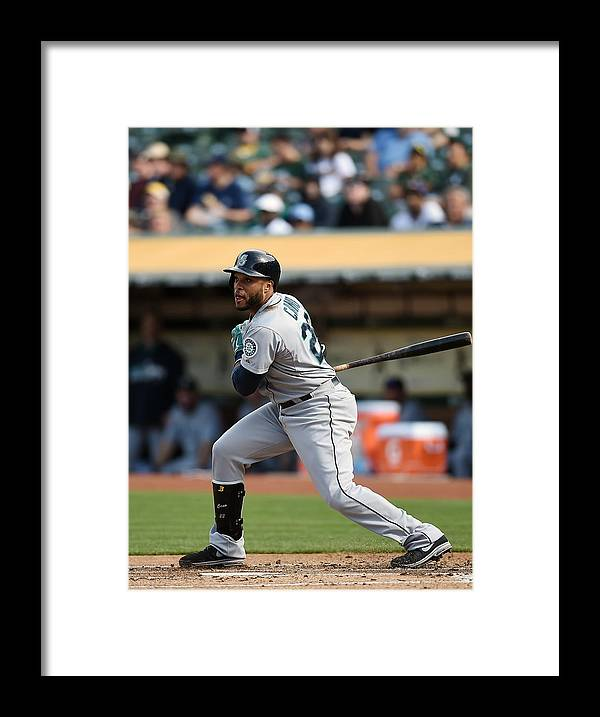 Game Two Framed Print featuring the photograph Seattle Mariners V Oakland Athletics - by Thearon W. Henderson