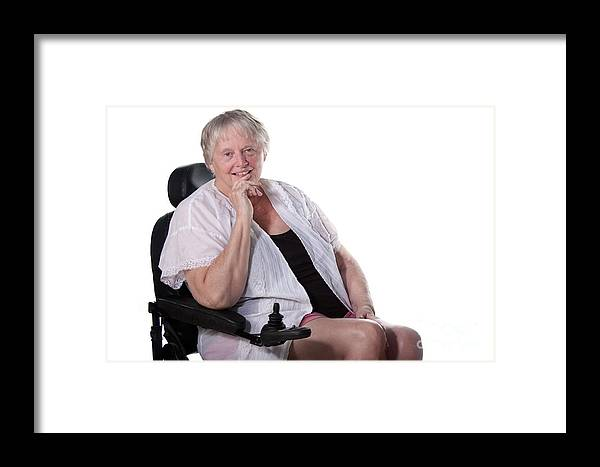 Adult Framed Print featuring the photograph Senior Woman In Wheel Chair by Gunter Nezhoda