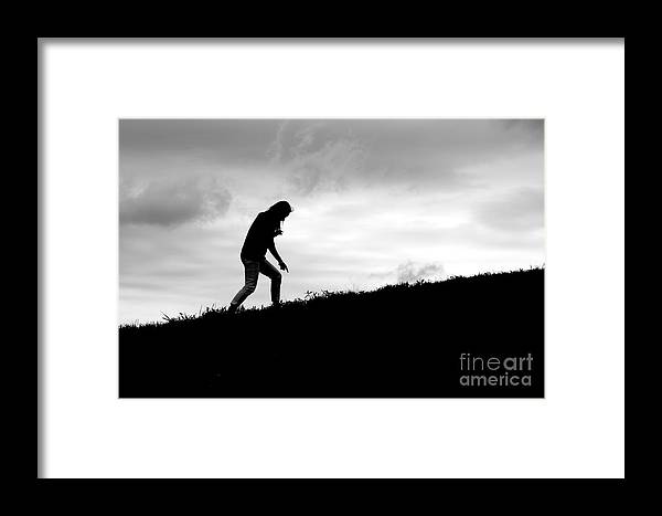 Art Framed Print featuring the photograph Silhouette Of Girl Pointing by Jannis Werner