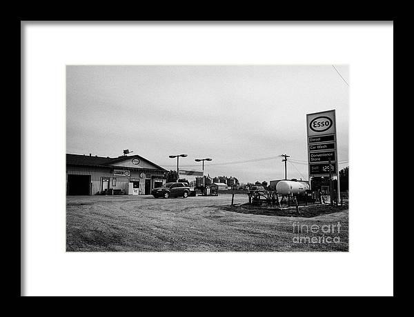 Small Framed Print featuring the photograph small roadside esso service gas station leader Saskatchewan Canada by Joe Fox