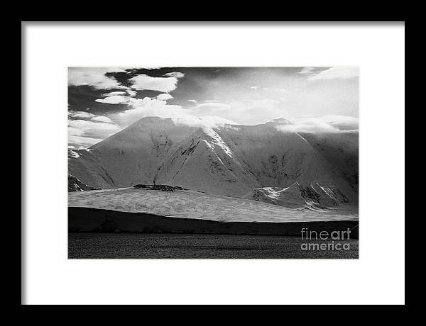 Snow Framed Print featuring the photograph snow covered landscape of anvers island and neumayer channel Antarctica by Joe Fox