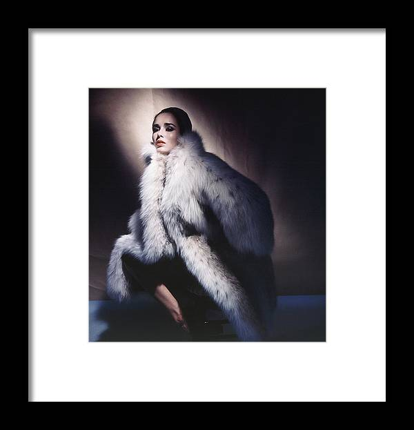 Studio Shot Framed Print featuring the photograph Sondra Peterson Wearing Fur Coat by Horst P. Horst