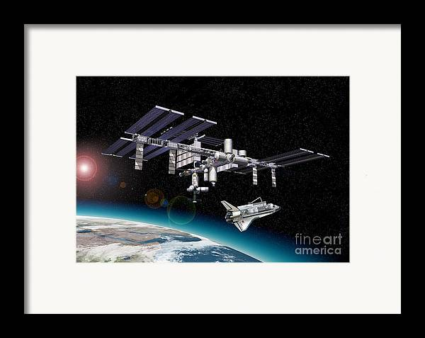 Three Dimensional Framed Print featuring the digital art Space Station In Orbit Around Earth by Leonello Calvetti