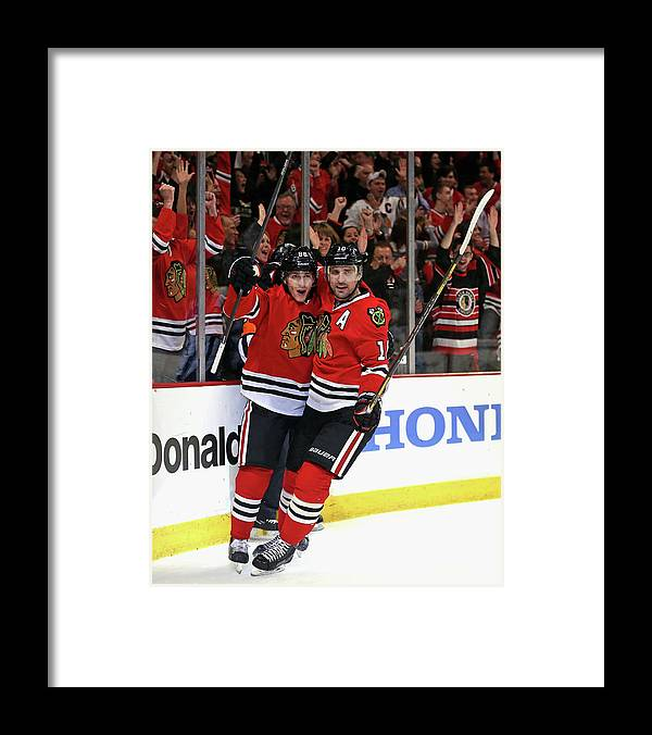 Playoffs Framed Print featuring the photograph St. Louis Blues V Chicago Blackhawks - by Jonathan Daniel