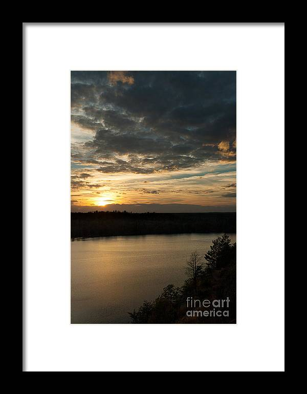 Aboda Klint Framed Print featuring the photograph sunset over Aboda Klint lake by Peter Noyce