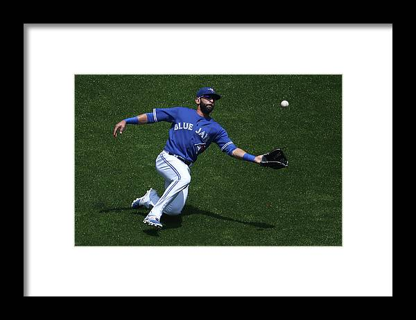 People Framed Print featuring the photograph Tampa Bay Rays V Toronto Blue Jays by Tom Szczerbowski