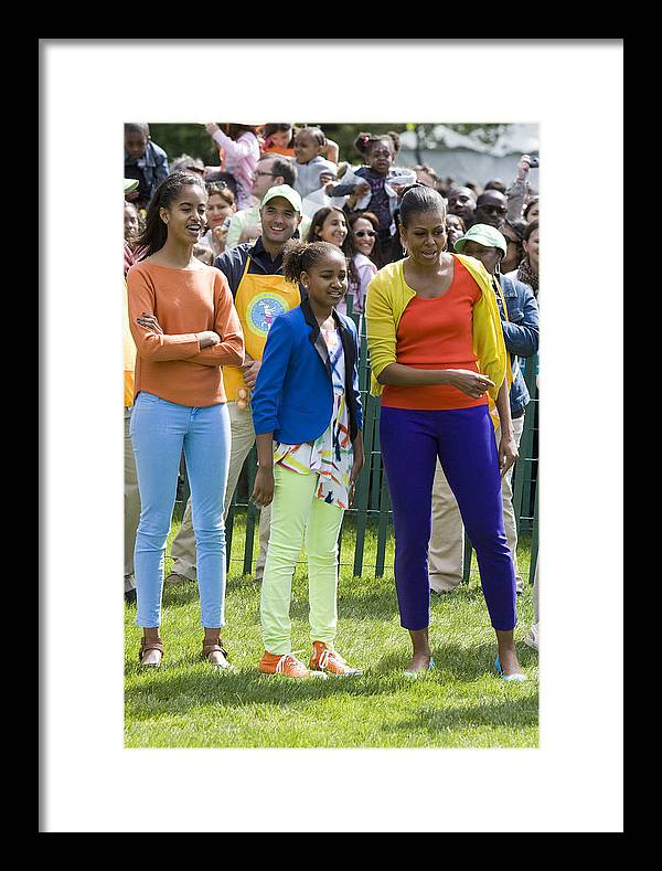 Easter Egg Roll South Lawn Easter Obama Barack Obama Michelle Obama Sasha Obama Malia Obama First Lady Fasion 2012 South Lawn White House Full Length Framed Print featuring the photograph The First Lady And Daughters by JP Tripp