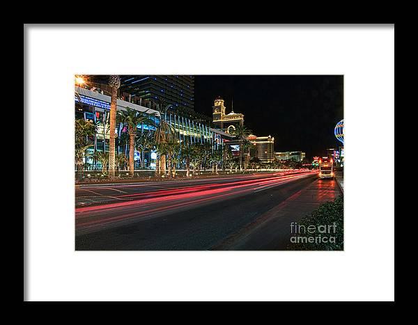 Las Vegas Framed Print featuring the photograph The Las Vegas Strip by Eddie Yerkish