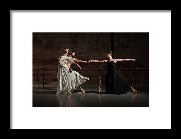 Young Men Framed Print featuring the photograph Three Ballet Dancers Performing Together by Nisian Hughes