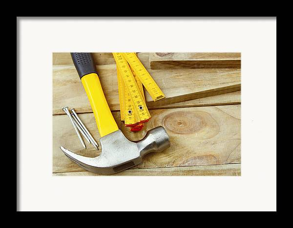 Nails Framed Print featuring the photograph Tools by Les Cunliffe