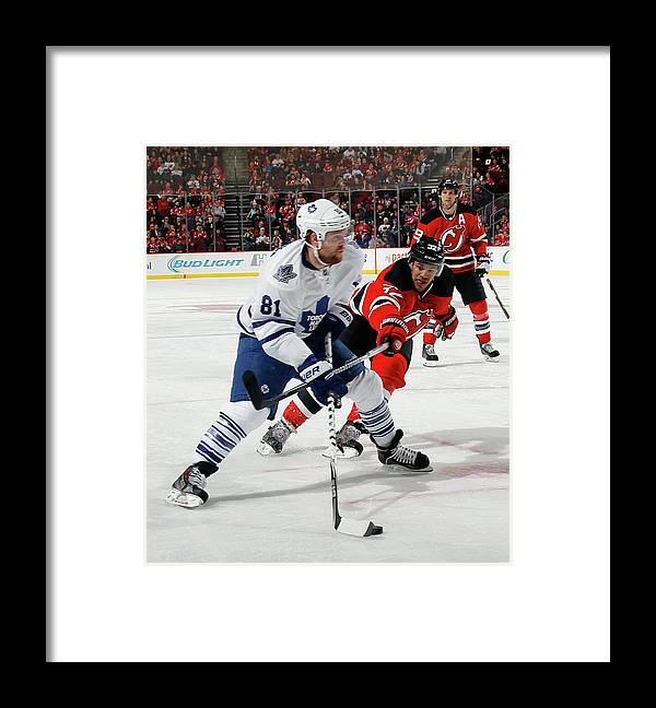 National Hockey League Framed Print featuring the photograph Toronto Maple Leafs V New Jersey Devils by Bruce Bennett
