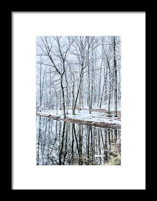 Tree Line Framed Print featuring the photograph Tree Line Reflections In Lake During Winter Snow Storm by Alex Grichenko