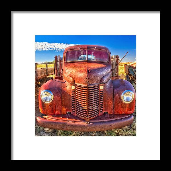 International Framed Print featuring the photograph International Rust by Daniel George