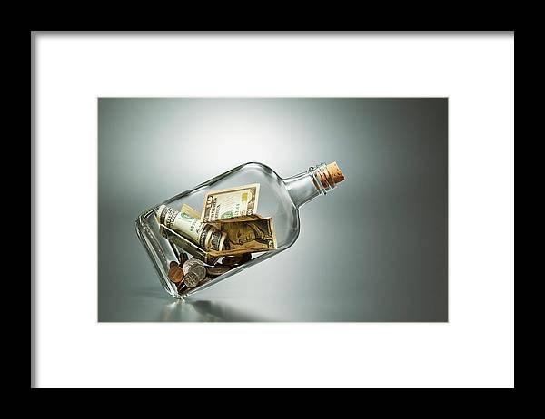 Coin Framed Print featuring the photograph Us Dollar Banknotes In A Bottle by Yuji Sakai