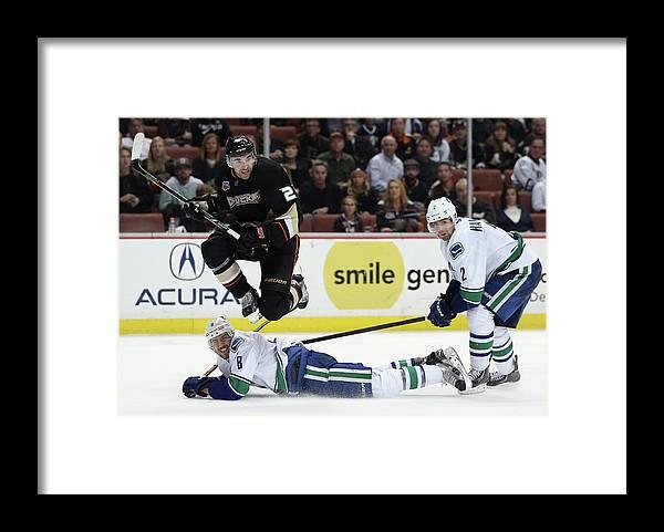 National Hockey League Framed Print featuring the photograph Vancouver Canucks V Anaheim Ducks by Jeff Gross