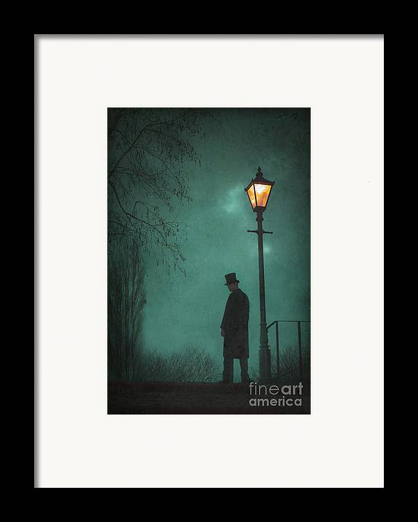 Victorian Framed Print featuring the photograph Victorian Man Standing Next To An Illuminated Gas Lamp by Lee Avison