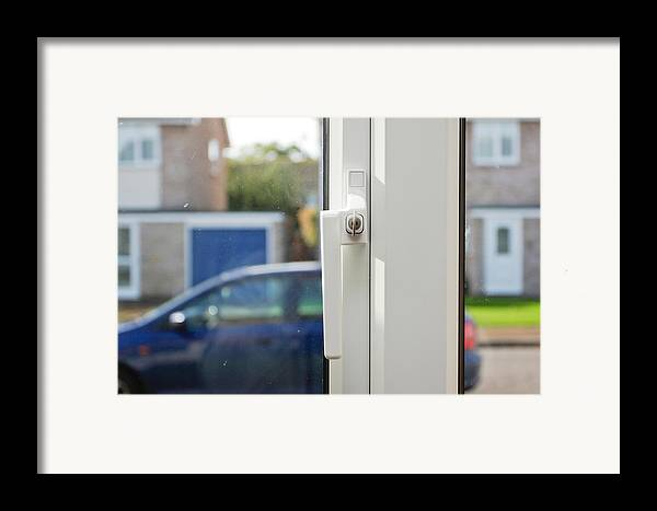 Anti-theft Framed Print featuring the photograph Window Lock by Tom Gowanlock