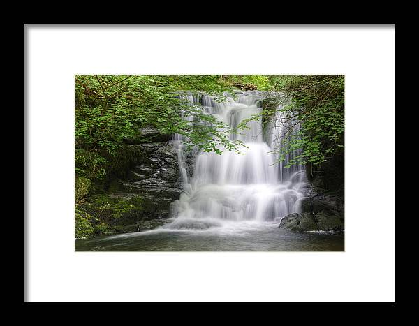 Waterfall Framed Print featuring the photograph Stunning Waterfall Flowing Over Rocks Through Lush Green Forest by Matthew Gibson