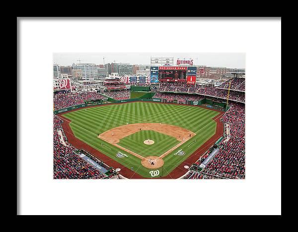 National League Baseball Framed Print featuring the photograph Atlanta Braves V. Washington Nationals by Mitchell Layton
